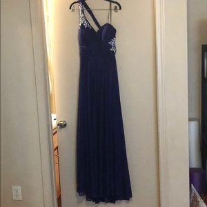 Purple one shoulder gown